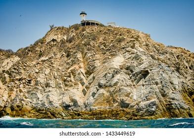 Lighthouse on the rock in Bahias de Huatulco, Mexico, Oaxaca