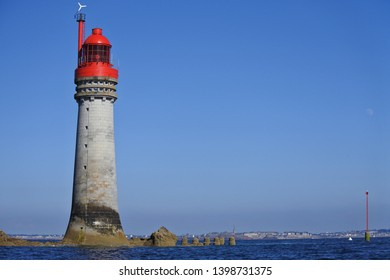 lighthouse on a rock in front of saint malo