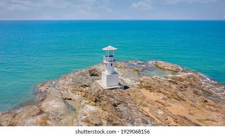 The lighthouse on rock island in the sea at Khao Lak beach,Phang Nga,Thailand.