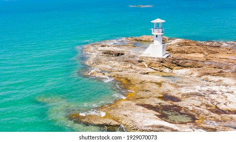 The lighthouse on rock in the sea at Khao Lak beach,Phang Nga,Thailand.