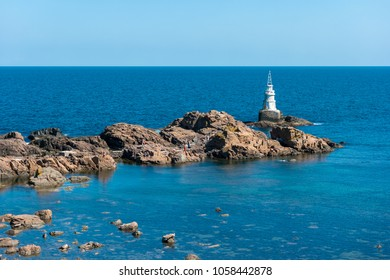 A lighthouse on the rocks. Black Sea. Ahtopol. Bulgaria.
