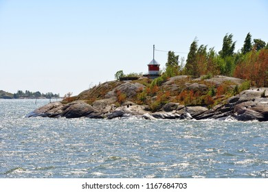 Lighthouse on rocky island of Helsinki archipelago, Finland