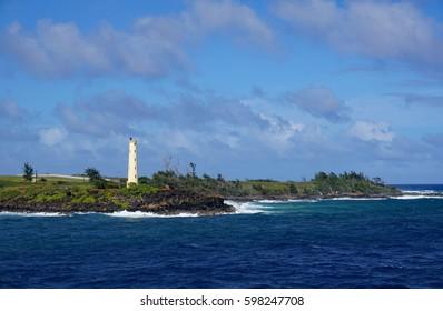 Lighthouse on a rocky shore near the Kauai Airport