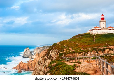 Lighthouse on the shore of Atlantic ocean in Cabo da Roca (Cape Roca) in Portugal. Westernmost point of continental Europe. Summer landscape