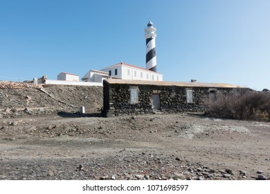 Lighthouse on the slate cape of Favaritx, Menorca, Balearic Islands, Spain