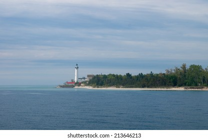 The lighthouse on South Manitou Island in Lake Michigan as seen from a boat.