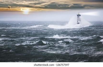 Lighthouse  on a stormy day , France