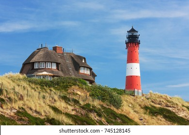 Lighthouse Hörnum on Sylt at the North Sea, Schleswig-Holstein, Germany with dunes.