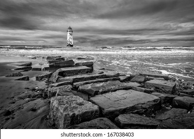 The �Point of Ayr� lighthouse on Talacre Beach  Wales in black and white with path on the beach,