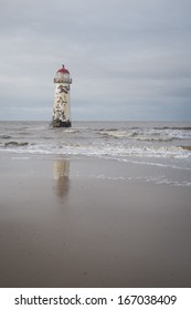 The �Point of Ayr� lighthouse on Talacre Beach  Wales with reflection in the water.