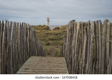The �Point of Ayr� lighthouse on Talacre Beach  Wales looking over the dunes to the lighthouse