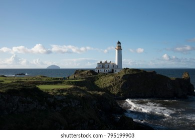 Lighthouse on Turnberry Golfcourse. In the background Ailsa Craig.