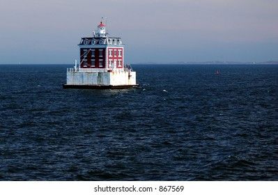 A lighthouse on the water.