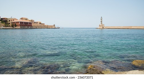 the lighthouse on the waterfront in the city of Chania in Crete, Greece