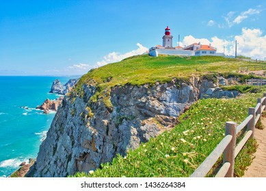 The lighthouse on westernmost european view point at the Cape Roca in Sintra region near Lisbon, Portugal in summer sunny day