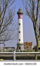 Lighthouse of Ouistreham between two trees, in the Calvados department in the Basse-Normandie region of France
