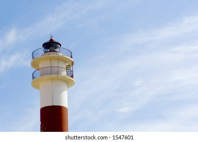 Lighthouse over blue sky in a sunny day in a spanish coast town