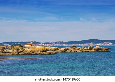 Lighthouse over Cabalo Point rocky cape in Arousa Island