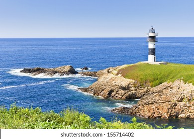 Lighthouse over Pancha island cliffs