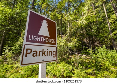 Lighthouse parking sign for a trail leading to the Pilot Bay Lighthouse on Kootenay Lake, British Columbia, Canada in the Pilot Bay Provincial Marine Park