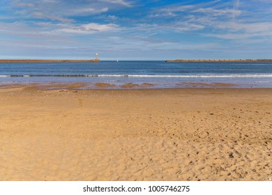 Lighthouse and pier at the North Sea coast of Roker Beach in Sunderland, Tyne and Wear, UK