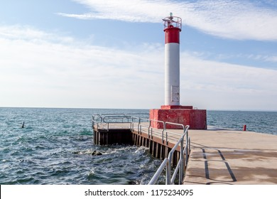 The lighthouse pier on Lake Ontario at Waterworks Park in Oakville, Ontario, Canada.