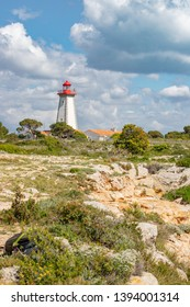 Lighthouse placed on the Cap Leucate over Mediterranean coast of Aude Department, southern France. A popular holyday destination of the Amethyst Coast where to practice Surfing or Diving.