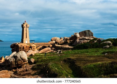 The lighthouse at Ploumanach on the Cote de Granite Rose in the Cotes-d Armor, Brittany, France