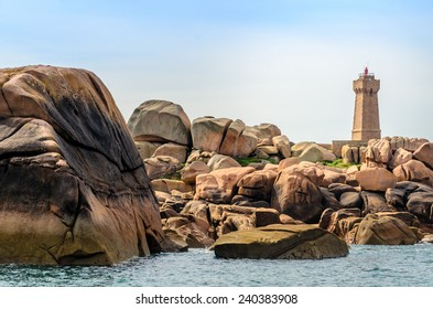 The lighthouse of Ploumanach, view from sea, Cote de granit rose in North Brittany, France