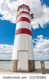Lighthouse in Podersdorf am See, lake Neusiedler See, Burgenland, Austria. Travelling theme.