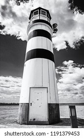 Lighthouse in Podersdorf am See, lake Neusiedler See, Burgenland, Austria. Travelling theme. Black and white photo.