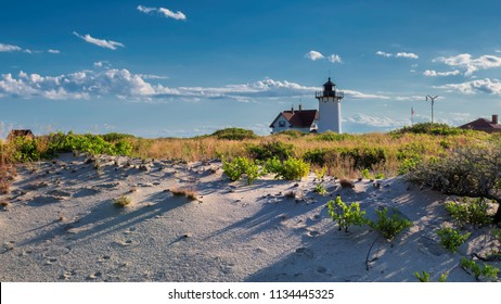 Lighthouse Point on beach dunes. Race Point Light Lighthouse in Cape Cod, New England, Massachusetts, USA.