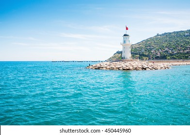 Lighthouse in the port of Alanya, Turkey. Beautiful summer landscape, sea view.