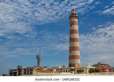 The Lighthouse of Praia da Barra, also known as the Aveiro Lighthouse - Portugal.