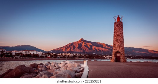 Lighthouse in Puerto Banus near Marbella with vintage effect