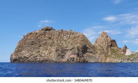 The Lighthouse, Punta della Guardia - Faro, on the top of spectacular steep rocky mountain. Beautiful landscape. Ponza. Pontine Islands. Italy. Travel around the island. Boat trip. Tyrrhenian Sea.
