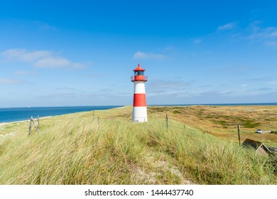 Lighthouse red white on dune. Sylt island – North Germany.   Focus on background with lighthouse.