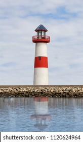 Lighthouse with reflection on water in California