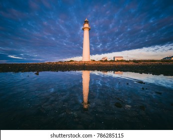 Lighthouse and reflections at sunrise