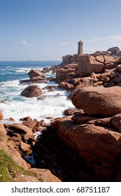lighthouse in the rocks on Pink Granite Coast in France