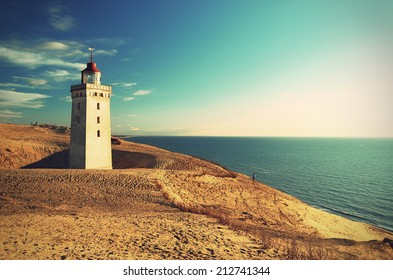 Lighthouse Rubjerg Knude and sand dunes at the danish North Sea coast, vintage style, Denmark, Europe