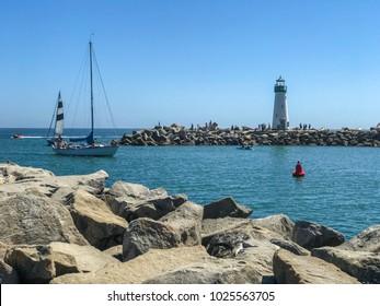 Lighthouse and sail boats, Santa Cruz, California, USA