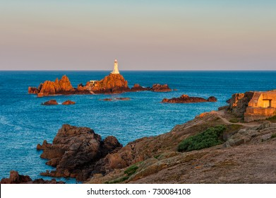 Lighthouse in Saint Helier, Jersey, Channel Islands, UK at sunrise and high tide
