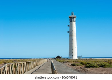 lighthouse and the sea in the background