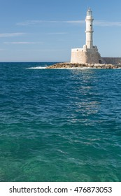 Lighthouse in sea with blue water in Chania, Crete, Greece