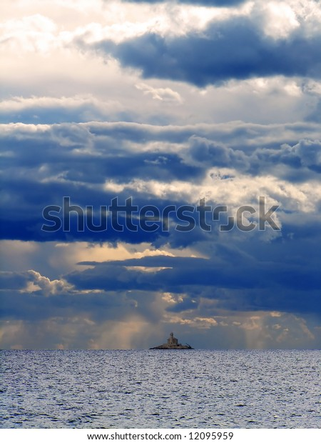 Lighthouse, sea and clouds before storm