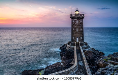 Lighthouse sea rock sunset view. Sunset lighthouse sea panorama. Lighthouse sea sunset landscape