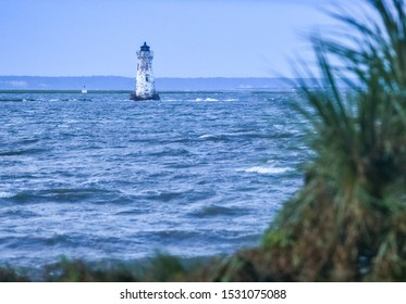 Lighthouse in the sea seen from Tybee Island, Georgia, United States