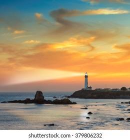 Lighthouse searchlight beam at sunset on California coast