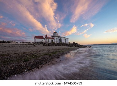 A lighthouse in Seattle at sunset